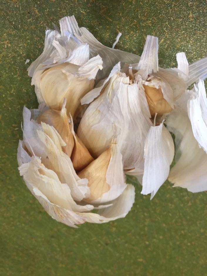Garlic bulb broken into cloves
