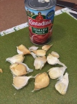 Smash garlic cloves with a can for easy peeling